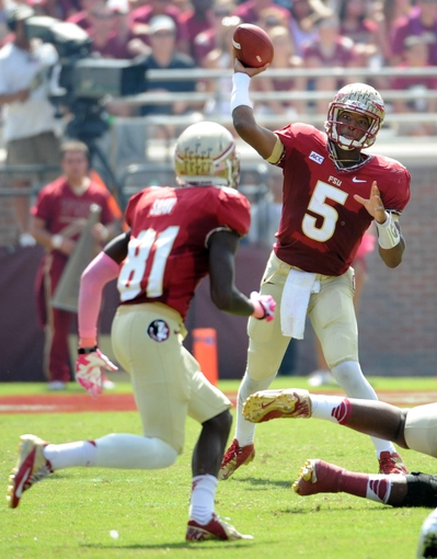 Oct 5, 2013; Tallahassee, FL, USA; Florida State Seminoles quarterback Jameis Winston (5) throws the ball to wide receiver Kenny Shaw (81) during the first quarter against the Maryland Terrapins at Doak Campbell Stadium. Mandatory Credit: Melina Vastola-USA TODAY Sports