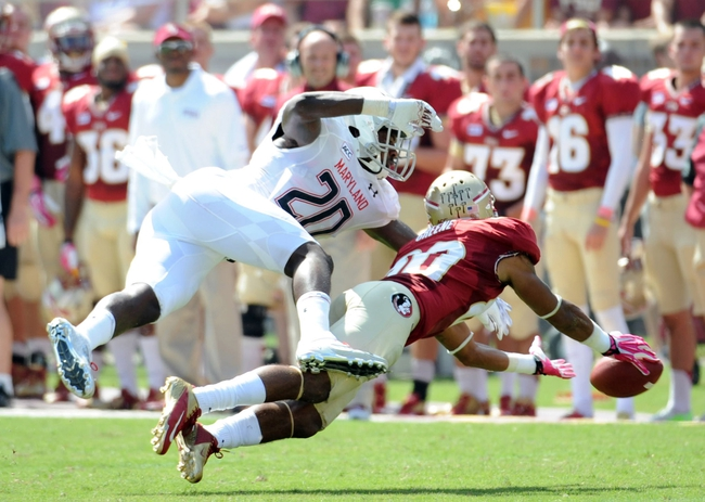 Oct 5, 2013; Tallahassee, FL, USA; Florida State Seminoles wide receiver Rashad Greene (80) has a pass broken up by Maryland Terrapins defensive back Anthony Nixon (20) during the first quarter of the game at Doak Campbell Stadium. Mandatory Credit: Melina Vastola-USA TODAY Sports