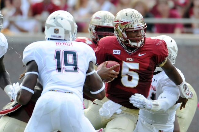 Oct 5, 2013; Tallahassee, FL, USA; Florida State Seminoles quarterback Jameis Winston (5) tries to run past Maryland Terrapins defensive back A.J. Hendy (19) during the second quarter at Doak Campbell Stadium. Mandatory Credit: Melina Vastola-USA TODAY Sports