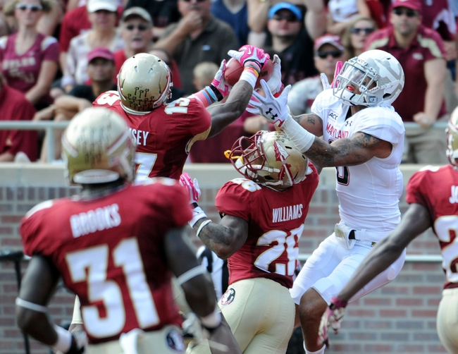 Oct 5, 2013; Tallahassee, FL, USA; Maryland Terrapins wide receiver Deon Long (6) cannot catch the ball while being defended by Florida State Seminoles defensive back Jalen Ramsey (13) and defensive back P.J. Williams (26) during the second quarter of the game at Doak Campbell Stadium. Mandatory Credit: Melina Vastola-USA TODAY Sports
