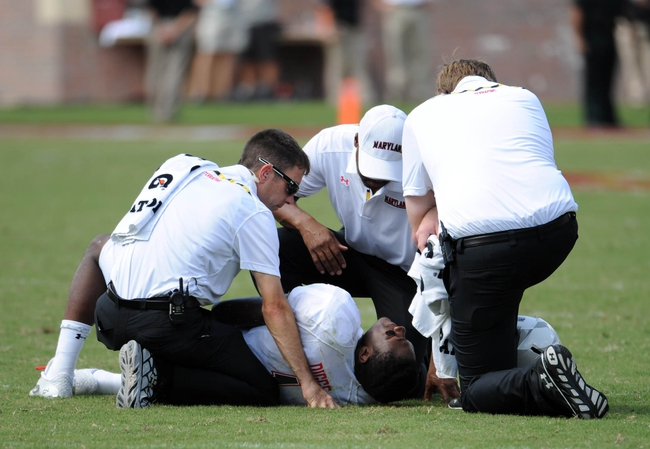Oct 5, 2013; Tallahassee, FL, USA; Maryland Terrapins wide receiver Stefon Diggs (1) lays on the ground after being injured on a play during the second half of the game against the Florida State Seminoles at Doak Campbell Stadium. Mandatory Credit: Melina Vastola-USA TODAY Sports