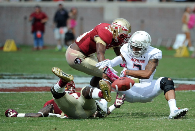 Oct 5, 2013; Tallahassee, FL, USA; Maryland Terrapins wide receiver Nigel King (3) turns the ball over after defense from Florida State Seminoles defensive back Terrence Brooks (31) and defensive back Jalen Ramsey (13) during the second half of the game at Doak Campbell Stadium. Mandatory Credit: Melina Vastola-USA TODAY Sports