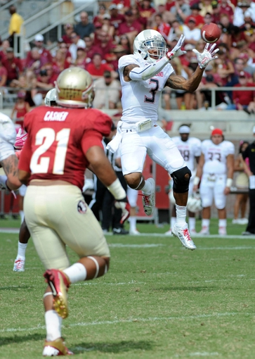 Oct 5, 2013; Tallahassee, FL, USA; Maryland Terrapins wide receiver Nigel King (3) hauls in a pass past Florida State Seminoles defensive end Chris Casher (21) during the second half of the game at Doak Campbell Stadium. Mandatory Credit: Melina Vastola-USA TODAY Sports