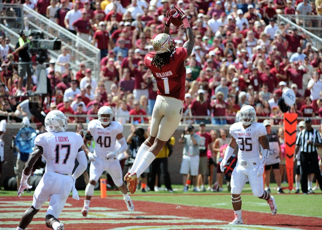 Oct 5, 2013; Tallahassee, FL, USA; Florida State Seminoles wide receiver Kelvin Benjamin (1) catches a touchdown pass during the game against the Maryland Terrapins at Doak Campbell Stadium. Mandatory Credit: Melina Vastola-USA TODAY Sports