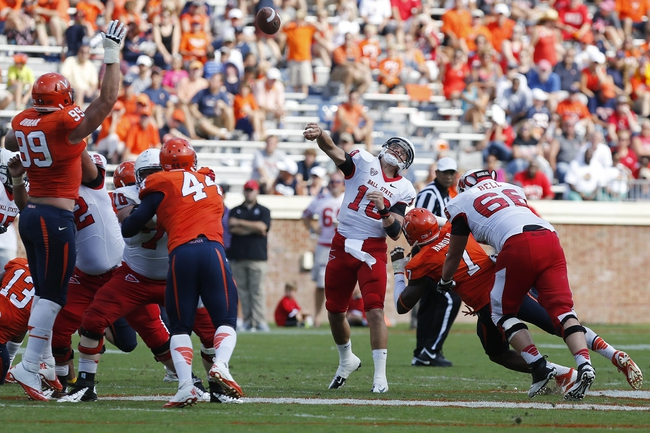 Oct 5, 2013; Charlottesville, VA, USA; Ball State Cardinals quarterback Keith Wenning (10) throws the ball against the Virginia Cavaliers in the third quarter at Scott Stadium. The Cardinals won 48-27. Mandatory Credit: Geoff Burke-USA TODAY Sports