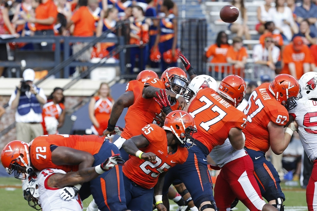 Oct 5, 2013; Charlottesville, VA, USA; Virginia Cavaliers quarterback David Watford (5) throws the ball against the Ball State Cardinals in the third quarter at Scott Stadium. The Cardinals won 48-27. Mandatory Credit: Geoff Burke-USA TODAY Sports