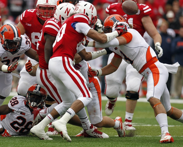 Oct 5, 2013; Lincoln, NE, USA; Nebraska Cornhuskers receiver Kenny Bell (80) fumbles the ball after being hit by Illinois Fighting Illini defender Taylor Barton (3) during the fourth quarter at Memorial Stadium. Illinois recovered the ball. Nebraska won 39-19. Mandatory Credit: Bruce Thorson-USA TODAY Sports
