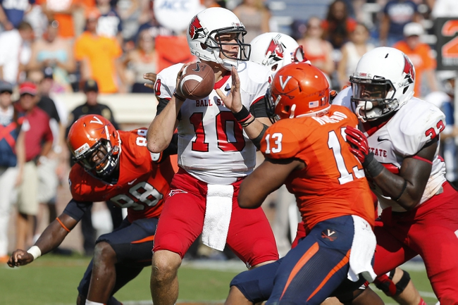 Oct 5, 2013; Charlottesville, VA, USA; Ball State Cardinals quarterback Keith Wenning (10) prepares to throw a pass against the Virginia Cavaliers in the fourth quarter at Scott Stadium. The Cardinals won 48-27. Mandatory Credit: Geoff Burke-USA TODAY Sports