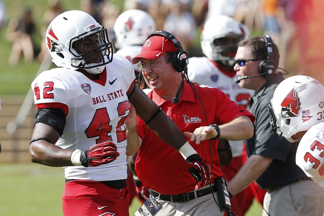 Oct 5, 2013; Charlottesville, VA, USA; Ball State Cardinals head coach Pete Lembo celebrates with Cardinals linebacker Julian Boyd (42) on the sidelines against the Virginia Cavaliers in the fourth quarter at Scott Stadium. The Cardinals won 48-27. Mandatory Credit: Geoff Burke-USA TODAY Sports