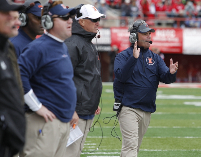 Oct 5, 2013; Lincoln, NE, USA; Illinois Fighting Illini head coach Tim Beckman applauds after his team scored a touchdown against the Nebraska Cornhuskers during the fourth quarter at Memorial Stadium. Nebraska won 39-19. Mandatory Credit: Bruce Thorson-USA TODAY Sports