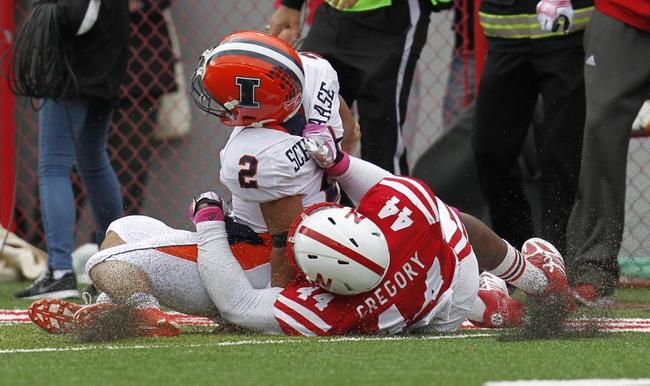 Oct 5, 2013; Lincoln, NE, USA; Nebraska Cornhuskers defender Randy Gregory (44) tackles Illinois Fighting Illini quarterback Nathan Scheelaase (2) during the fourth quarter at Memorial Stadium. Nebraska won 39-19. Mandatory Credit: Bruce Thorson-USA TODAY Sports