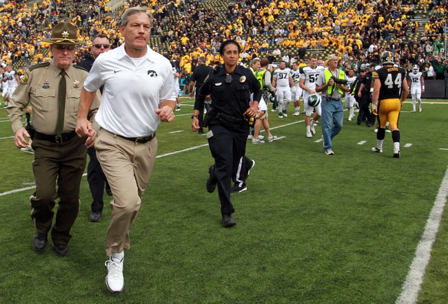 Oct 5, 2013; Iowa City, IA, USA;  Iowa Hawkeyes coach Kirk Ferentz runs off the field after their loss against the Michigan State Spartans at Kinnick Stadium. Michigan State beat Iowa 26-14.  Mandatory Credit: Reese Strickland-USA TODAY Sports