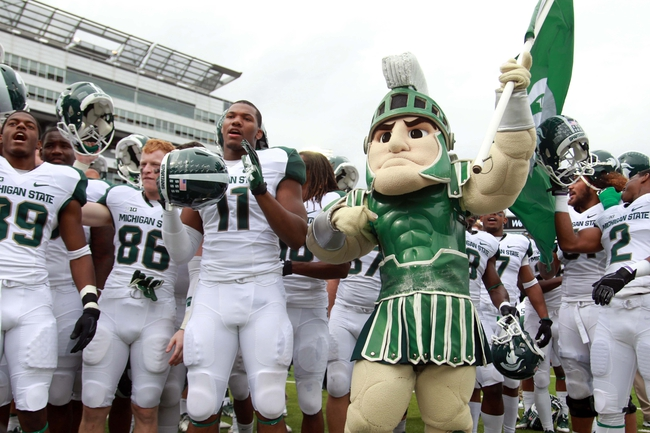 Oct 5, 2013; Iowa City, IA, USA;  Michigan State Spartans mascot Sparty celebrates with the rest of the team after their win against the Iowa Hawkeyes at Kinnick Stadium. Michigan State beat Iowa 26-14.  Mandatory Credit: Reese Strickland-USA TODAY Sports