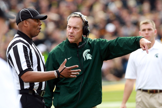 Oct 5, 2013; Iowa City, IA, USA;  Michigan State Spartans coach Mark Dantonio talks to the official during their game against the Iowa Hawkeyes at Kinnick Stadium. Michigan State beat Iowa 26-14.  Mandatory Credit: Reese Strickland-USA TODAY Sports