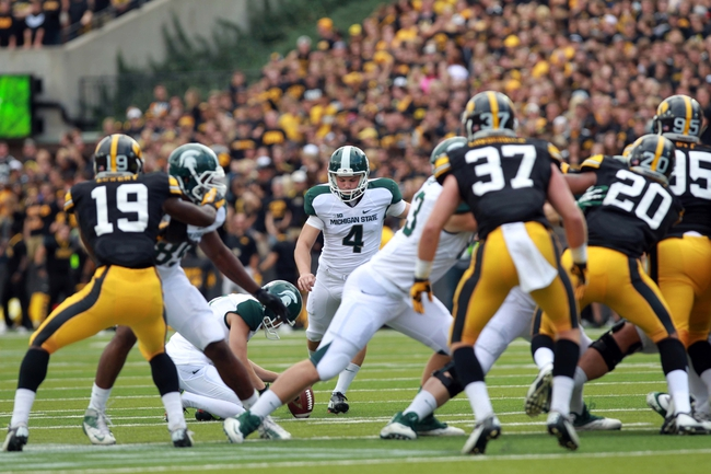 Oct 5, 2013; Iowa City, IA, USA;  Michigan State Spartans kicker Michael Geiger (4) kicks a field goal in the 4th quarter against the Iowa Hawkeyes at Kinnick Stadium. Michigan State beat Iowa 26-14.  Mandatory Credit: Reese Strickland-USA TODAY Sports
