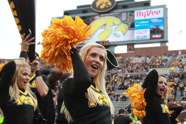 Oct 5, 2013; Iowa City, IA, USA;  Iowa Hawkeyes cheerleaders perform during their game against the Michigan State Spartans at Kinnick Stadium.  Michigan State beat Iowa 26-14.  Mandatory Credit: Reese Strickland-USA TODAY Sports