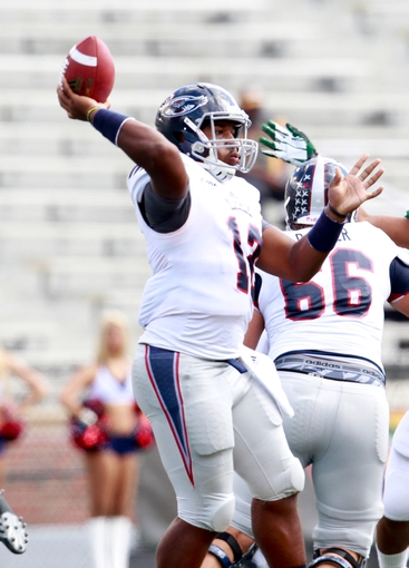 Oct 5, 2013; Birmingham, AL, USA;  Florida Atlantic Owls quarterback Jaquez Johnson (12) passes against the UAB Blazers at Legion Field. Mandatory Credit: Marvin Gentry-USA TODAY Sports