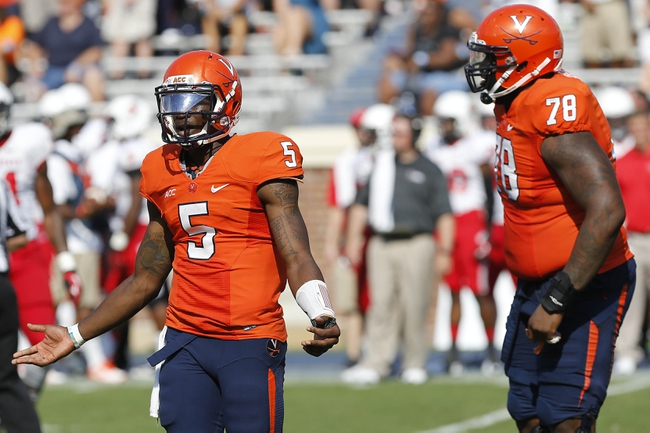 Oct 5, 2013; Charlottesville, VA, USA; Virginia Cavaliers quarterback David Watford (5) gestures on the field against the Ball State Cardinals in the fourth quarter at Scott Stadium. The Cardinals won 48-27. Mandatory Credit: Geoff Burke-USA TODAY Sports