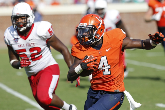Oct 5, 2013; Charlottesville, VA, USA; Virginia Cavaliers running back Taquan Mizzell (4) carries the ball as Ball State Cardinals defensive end Nick Miles (52) chases in the fourth quarter at Scott Stadium. The Cardinals won 48-27. Mandatory Credit: Geoff Burke-USA TODAY Sports