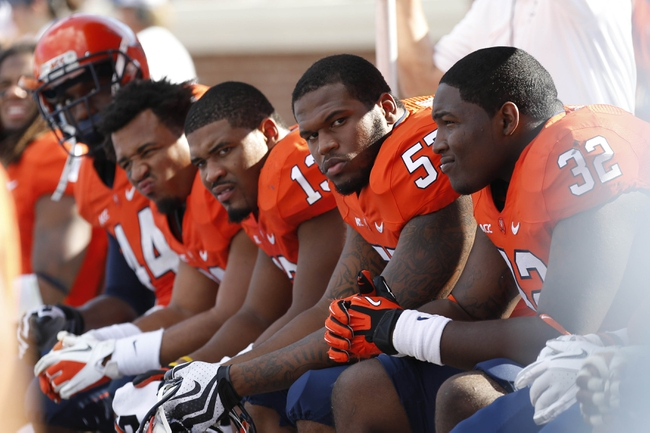 Oct 5, 2013; Charlottesville, VA, USA; Virginia Cavaliers players watch from the bench against the Ball State Cardinals fourth quarter at Scott Stadium. The Cardinals won 48-27. Mandatory Credit: Geoff Burke-USA TODAY Sports