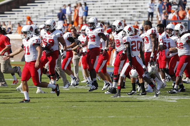 Oct 5, 2013; Charlottesville, VA, USA; Ball State Cardinals players celebrate on the field after their game against the Virginia Cavaliers at Scott Stadium. The Cardinals won 48-27. Mandatory Credit: Geoff Burke-USA TODAY Sports