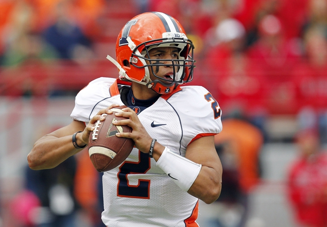 Oct 5, 2013; Lincoln, NE, USA; Illinois Fighting Illini quarterback Nathan Scheelaase (2) throws against the Nebraska Cornhuskers during the second quarter at Memorial Stadium. Nebraska won 39-19. Mandatory Credit: Bruce Thorson-USA TODAY Sports