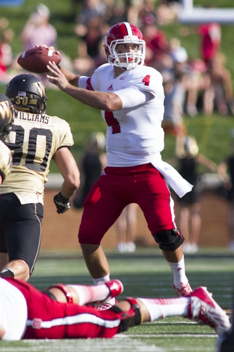 Oct 5, 2013; Winston-Salem, NC, USA; North Carolina State Wolfpack quarterback Pete Thomas (4) throws a pass during the second quarter against the Wake Forest Demon Deacons at BB&T Field. Mandatory Credit: Jeremy Brevard-USA TODAY Sports
