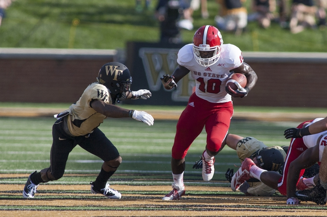 Oct 5, 2013; Winston-Salem, NC, USA; North Carolina State Wolfpack running back Shadrach Thornton (10) runs the ball during the second quarter against the Wake Forest Demon Deacons at BB&T Field. Mandatory Credit: Jeremy Brevard-USA TODAY Sports