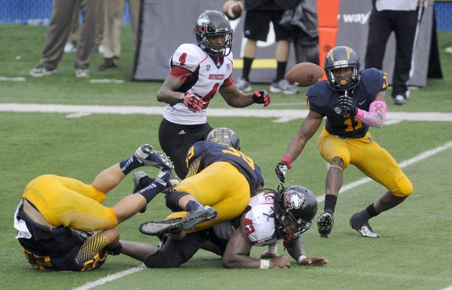 Oct 5, 2013; Kent, OH, USA; Northern Illinois Huskies running back Cameron Stingily (42) loses the ball as he crosses the goal line as Kent State Golden Flashes cornerback Darius Polk (11) and Kent State Golden Flashes safety Luke Wollet (39) close in during the second quarter  at Dix Stadium. Stingily was ruled down at the one. Mandatory Credit: Ken Blaze-USA TODAY Sports