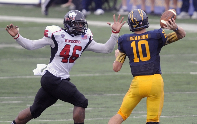 Oct 5, 2013; Kent, OH, USA; Northern Illinois Huskies defensive end George Rainey (46) pressures Kent State Golden Flashes quarterback Colin Reardon (10) during the second quarter at Dix Stadium. Mandatory Credit: Ken Blaze-USA TODAY Sports