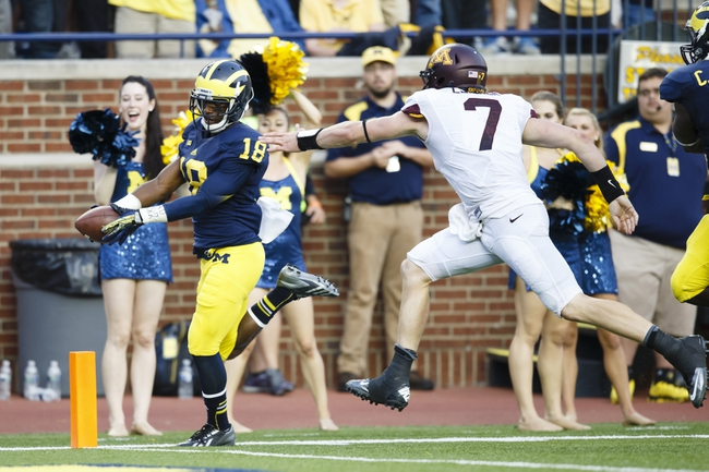 Oct 5, 2013; Ann Arbor, MI, USA; Michigan Wolverines defensive back Blake Countess (18) scores a touchdown on a seventy two yard interception return as Minnesota Golden Gophers quarterback Mitch Leidner (7) tries to catch him in the fourth quarter at Michigan Stadium. Michigan won 42-13. Mandatory Credit: Rick Osentoski-USA TODAY Sports