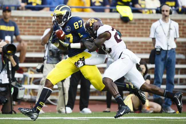 Oct 5, 2013; Ann Arbor, MI, USA; Michigan Wolverines tight end Devin Funchess (87) makes a forty six yard reception over Minnesota Golden Minnesota Golden Gophers defensive back Jeremy Baltazar (22) in the fourth quarter at Michigan Stadium. Michigan won 42-13. Mandatory Credit: Rick Osentoski-USA TODAY Sports