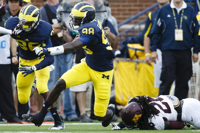 Oct 5, 2013; Ann Arbor, MI, USA; Michigan Wolverines quarterback Devin Gardner (98) runs the ball in the third quarter against the Minnesota Golden Gophers at Michigan Stadium. Michigan won 42-13. Mandatory Credit: Rick Osentoski-USA TODAY Sports