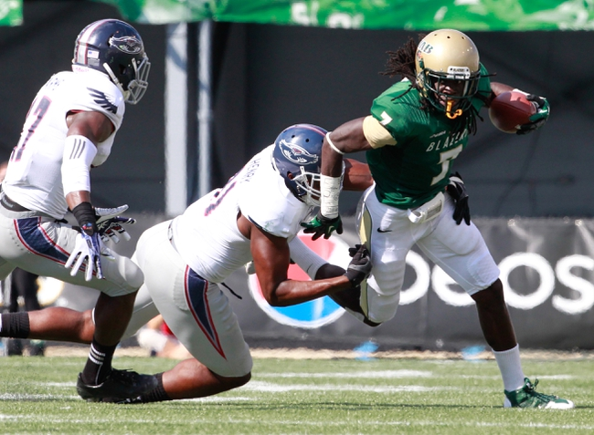Oct 5, 2013; Birmingham, AL, USA; UAB Blazers running back Jordan Howard (7) is grabbed from behind by Florida Atlantic Owlsdefensive end Joe Henry  (92)  at Legion Field. Mandatory Credit: Marvin Gentry-USA TODAY Sports