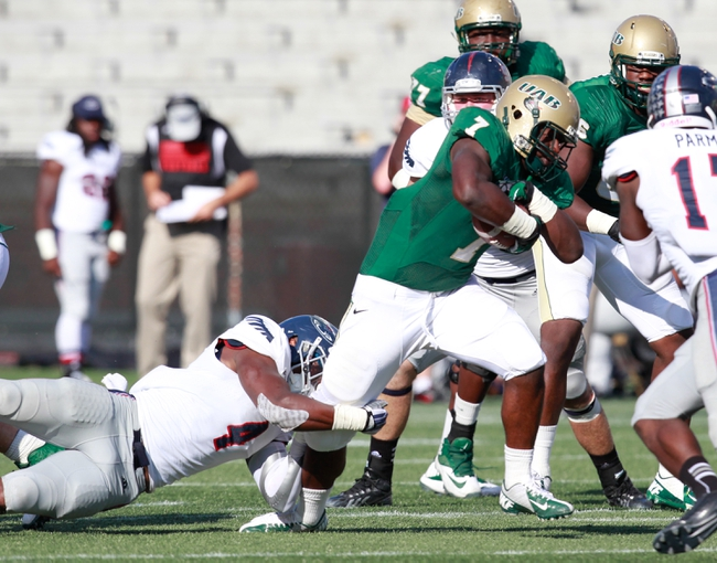 Oct 5, 2013; Birmingham, AL, USA;  UAB Blazers running back Jordan Howard (7) is grabbed from behind by Florida Atlantic Owls linebacker Adar