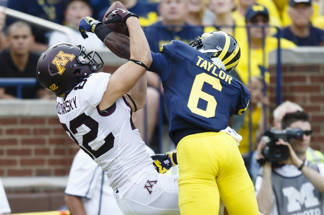 Oct 5, 2013; Ann Arbor, MI, USA; Michigan Wolverines defensive back Raymon Taylor (6) breaks up a pass to Minnesota Golden Gophers wide receiver Drew Wolitarsky (82) in the second half at Michigan Stadium. Michigan won 42-13. Mandatory Credit: Rick Osentoski-USA TODAY Sports