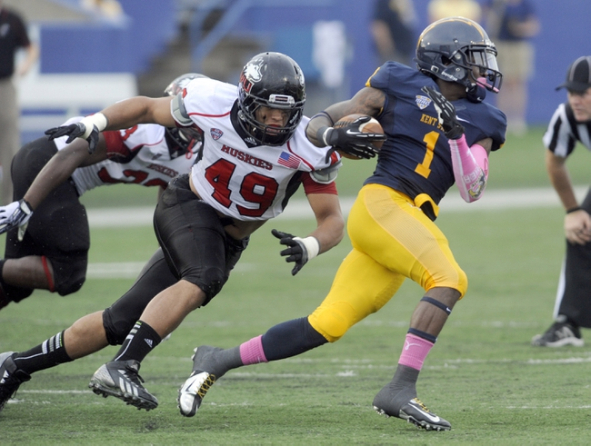 Oct 5, 2013; Kent, OH, USA; Kent State Golden Flashes running back Dri Archer (1) runs as Northern Illinois Huskies defensive end Jason Meehan (49) chases during the third quarter at Dix Stadium. Northern Illinois beat Kent State 38-24. Mandatory Credit: Ken Blaze-USA TODAY Sports