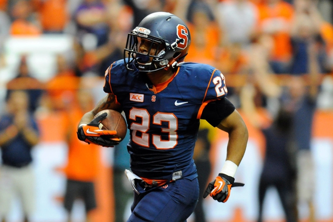 Oct 5, 2013; Syracuse, NY, USA; Syracuse Orange running back Prince-Tyson Gulley (23) runs with the ball on his way to the end zone for a touchdown during the third quarter against the Clemson Tigers at the Carrier Dome.  Clemson defeated Syracuse 49-14.  Mandatory Credit: Rich Barnes-USA TODAY Sports