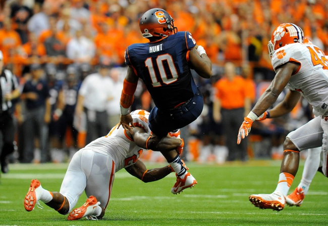 Oct 5, 2013; Syracuse, NY, USA; Syracuse Orange quarterback Terrel Hunt (10) goes airborne while being tackled during the third quarter against the Clemson Tigers at the Carrier Dome.  Clemson defeated Syracuse 49-14.  Mandatory Credit: Rich Barnes-USA TODAY Sports