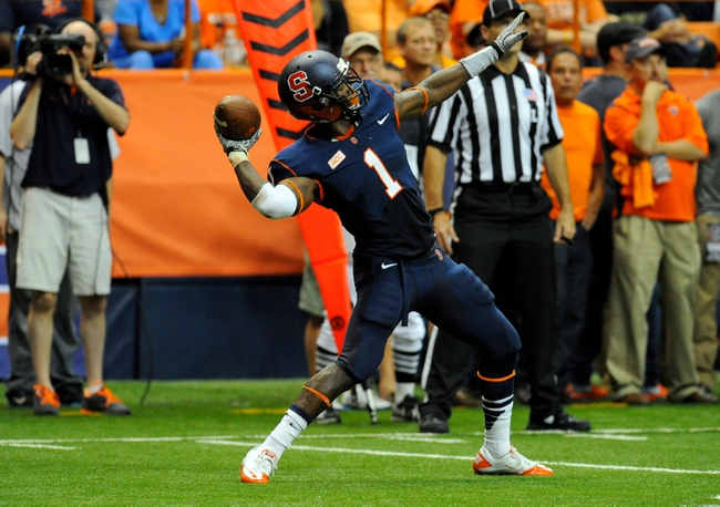 Oct 5, 2013; Syracuse, NY, USA; Syracuse Orange running back Ashton Broyld (1) throws a pass during the third quarter against the Clemson Tigers at the Carrier Dome.  Clemson defeated Syracuse 49-14.  Mandatory Credit: Rich Barnes-USA TODAY Sports