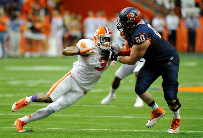 Oct 5, 2013; Syracuse, NY, USA; Clemson Tigers defensive end Vic Beasley (3) is blocked by Syracuse Orange offensive tackle Sean Hickey (60) during the third quarter at the Carrier Dome.  Clemson defeated Syracuse 49-14.  Mandatory Credit: Rich Barnes-USA TODAY Sports
