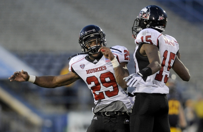 Oct 5, 2013; Kent, OH, USA; Northern Illinois Huskies cornerback Paris Logan (29) and safety Jimmie Ward (15) celebrate during the fourth quarter at Dix Stadium. Northern Illinois beat Kent State 38-24. Mandatory Credit: Ken Blaze-USA TODAY Sports