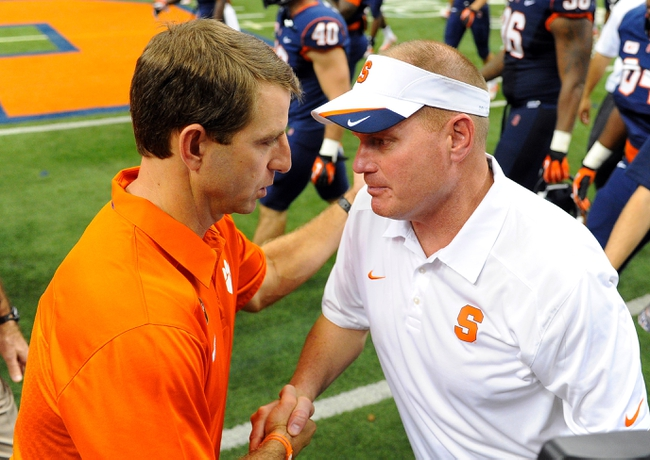 Oct 5, 2013; Syracuse, NY, USA; Clemson Tigers head coach Dabo Swinney (left) and Syracuse Orange head coach Scott Shafer (right) shake hands following the game at the Carrier Dome.  Clemson defeated Syracuse 49-14.  Mandatory Credit: Rich Barnes-USA TODAY Sports