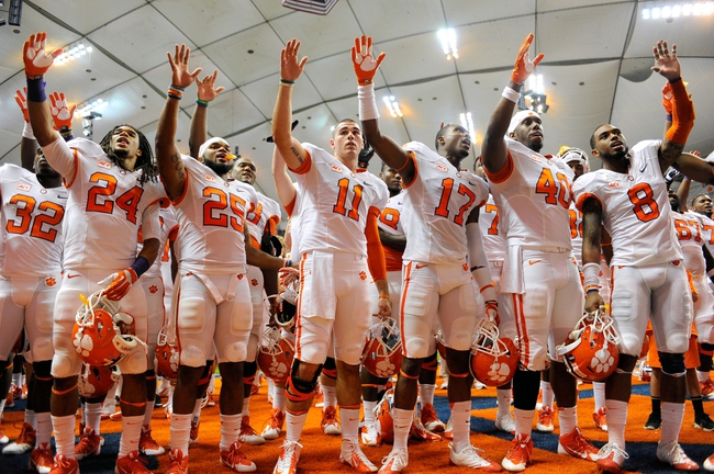 Oct 5, 2013; Syracuse, NY, USA; Clemson Tigers players gesture to the crowd following the game against the Syracuse Orange at the Carrier Dome.  Clemson defeated Syracuse 49-14.  Mandatory Credit: Rich Barnes-USA TODAY Sports