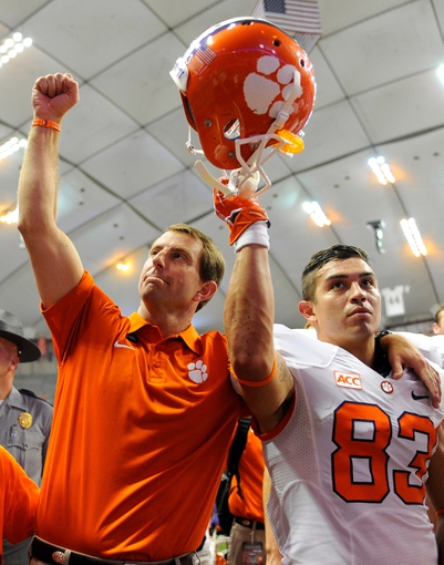 Oct 5, 2013; Syracuse, NY, USA; Clemson Tigers head coach Dabo Swinney (left) and wide receiver Daniel Rodriguez (83) gesture to the crowd following the game at the Carrier Dome.  Clemson defeated Syracuse 49-14.  Mandatory Credit: Rich Barnes-USA TODAY Sports