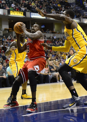 Oct 5, 2013; Indianapolis, IN, USA; Chicago Bulls small forward Luol Deng (9) attempts a layup against the Indiana Pacers at Bankers Life Fieldhouse. Mandatory Credit: Marc Lebryk-USA TODAY Sports