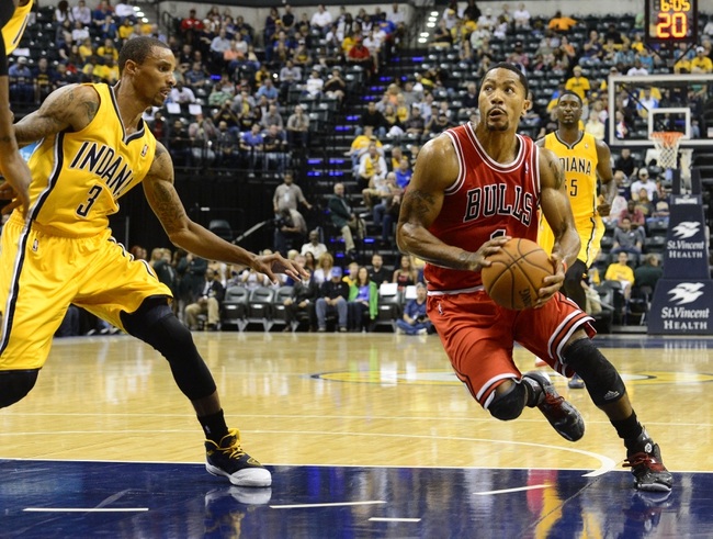 Oct 5, 2013; Indianapolis, IN, USA; Chicago Bulls point guard Derrick Rose (1) makes a run towards the basket against Indiana Pacers point guard George Hill (3) at Bankers life Fieldhouse. Mandatory Credit: Marc Lebryk-USA TODAY Sports