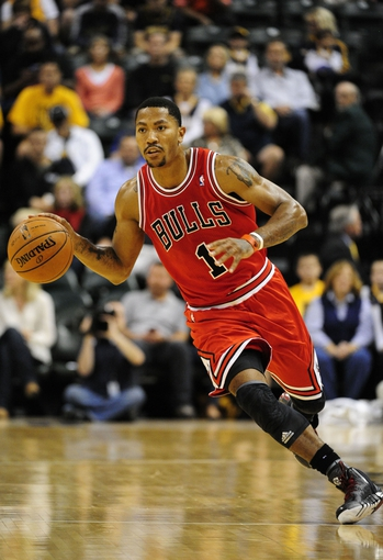 Oct 5, 2013; Indianapolis, IN, USA; Chicago Bulls point guard Derrick Rose (1) brings the ball back to the Bulls basket at Bankers life Fieldhouse. Mandatory Credit: Marc Lebryk-USA TODAY Sports