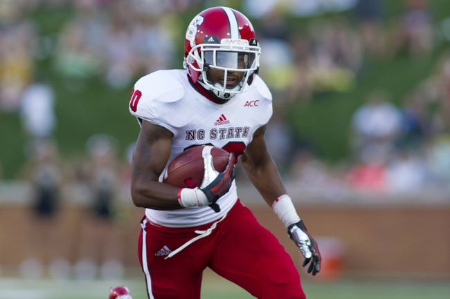 Oct 5, 2013; Winston-Salem, NC, USA; North Carolina State Wolfpack running back Shadrach Thornton (10) runs the ball during the third quarter against the Wake Forest Demon Deacons at BB&T Field. Wake defeated North Carolina State 28-13. Mandatory Credit: Jeremy Brevard-USA TODAY Sports