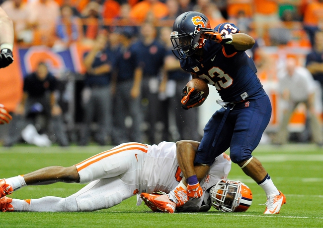 Oct 5, 2013; Syracuse, NY, USA; Clemson Tigers defensive end Vic Beasley (3) holds the leg of Syracuse Orange running back Prince-Tyson Gulley (23) during the third quarter at the Carrier Dome.  Clemson defeated Syracuse 49-14.  Mandatory Credit: Rich Barnes-USA TODAY Sports